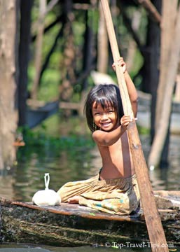 Young girl traveling alone on a small boat