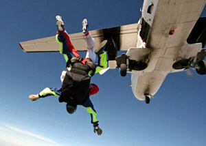 Man parachuting from airplane