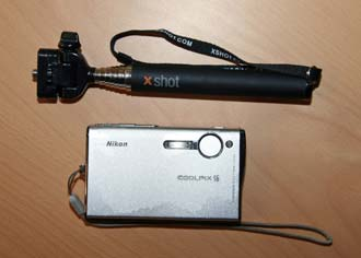 Pocket Xshot camera extender next to Nikon pocket camera
