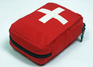 Red colored first aid travel kit