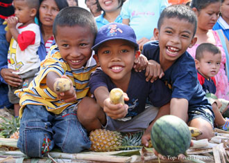 Kids in Surin Thailand offering fruits