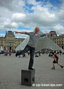 Man standing in front Louvre main entrance