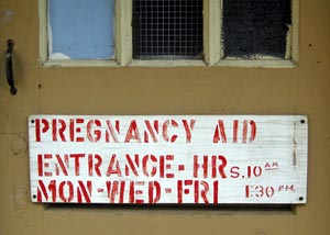 Sign for pregnancy clinic opening hours
