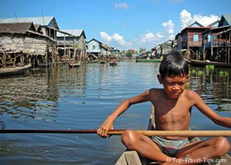 Young boy in his boat in floating village Thailand