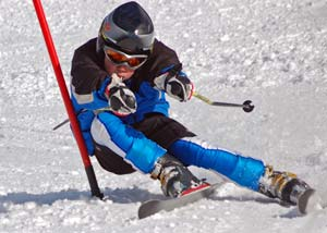 Young skiier in skiing in a ski competition