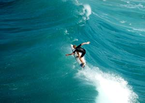 Surfer surfing on a large wave