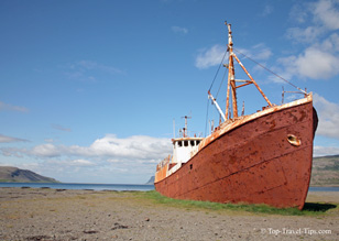 Old trawler on a beach in Iceland