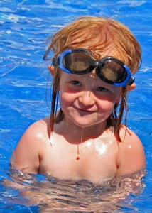 Kid smiling in swimming pool