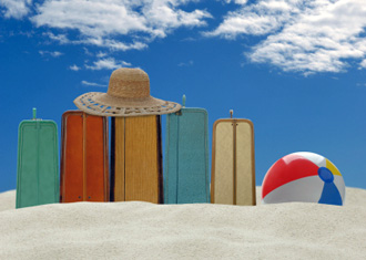 Travel accessories - suitcases, hat and beach ball