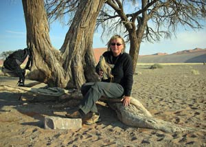 Asa Gislason owner of top-travel-tips.com emptying sand from her shoe in Namibia