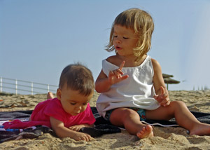 Two kids playing on a beach