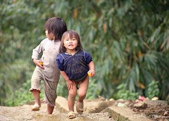 Two children playing in small village in Sapa Vietnam