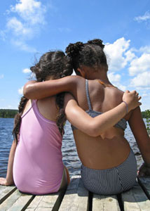 Two young girl holding arms