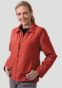 Woman wearing red colored Scottevest carryon luggage vest
