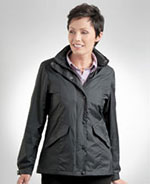 Woman wearing dark colored rain jacket