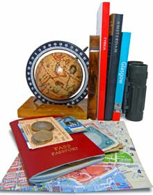 Passport, street map and travel books for trip planning