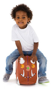 Young boy sitting on top of his children luggage